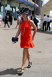 A female racegoer arrives during day two of Royal Ascot at Ascot Racecourse.