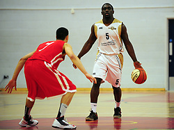 Essex Leopards' Simon Cummings looks for options whilst advancing on Bristol Academy Flyers' Roy Owen - Photo mandatory by-line: Dougie Allward/JMP - Tel: Mobile: 07966 386802 23/03/2013 - SPORT - Basketball - WISE Basketball Arena - SGS College - Bristol -  Bristol Academy Flyers V Essex Leopards