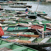 Rowing boats witing for passengers on Ngo Dong RIver in Northern Vietnam