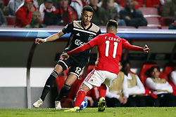 (l-r) Noussair Mazraoui of Ajax, Franco Cervi of SL Benfica during the UEFA Champions League group E match between  SL Benfica and Ajax Amsterdam at Estadio La Luz on November 97, 2018 in Lisbon, Portugal