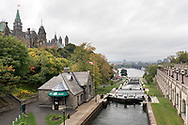 The Parliament Buildings, Ottawa Locks 1-8 lock station, Rideau Canal and the Ottawa river on a fall day.  Photographed at from the Plaza Bridge in Ottawa, Ontario, Canada.