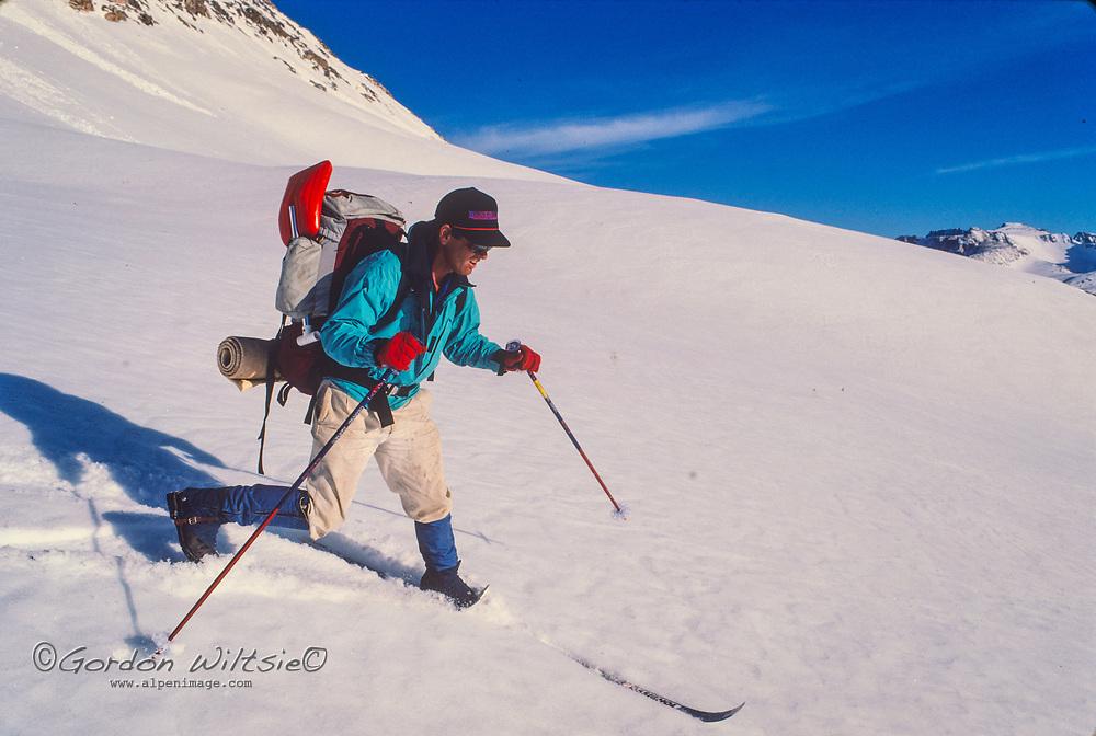 Ski Mountaneers descend through Humphreys Basin in the John Muir Wilderness, Sierra Nevada, California