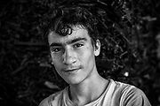 Wilyem 18yrs Idlib Black and white portrait of an informal rubbish collector in Istanbul Turkey. <br /> In Turkey, there are estimated to be as many as 500,000 waste pickers (toplayıcılar): Those making a living via the collection of recyclables off the street and from waste bins. <br /> The Ankara-based Street Waste Collectors Association (Sokak Atık Toplayıcıları Derneği) is demanding the creation of a legislation recognizing waste picking as a formal profession.<br /> John Wreford is a freelance professional photographer based in Turkey