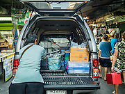 31 DECEMBER 2015 - BANGKOK, THAILAND: A street food vendor packs his belongings into his pickup truck on the last official day of business in Bang Chak Market. The market is supposed to close permanently on Dec 31, 2015. The Bang Chak Market serves the community around Sois 91-97 on Sukhumvit Road in the Bangkok suburbs. About half of the market has been torn down. Bangkok city authorities put up notices in late November that the market would be closed by January 1, 2016 and redevelopment would start shortly after that. Market vendors said condominiums are being built on the land.          PHOTO BY JACK KURTZ