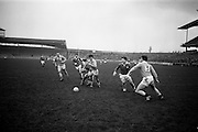 16/02/1964<br /> 02/16/1964<br /> 16 February 1964<br /> Railway Cup Football Semi Final: Munster v Ulster at Croke Park, Dublin. Ulster full back, L. Murphy (right) running after the ball towards his own goalmouth, but the ball went wide.