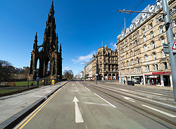 Edinburgh, Scotland, UK. 8 April 2020. Images from Edinburgh during the continuing Coronavirus lockdown. Pictured; View of an empty Princes Street. Iain Masterton/Alamy Live News.