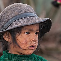 A kid seen along the street leading from Moray to Maras Village.