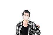 Derelict youth smokes a cigarette On white Background