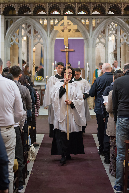 20 April 2019, Jerusalem: Deacon Della Wells carries the cross as the procession enters, during Easter Sunday service at the Cathedral Church of Saint George the Martyr, Jerusalem.