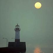 Morning sunrise, lighthouse at Canal Park; Duluth Port. Summer.Minnesota.
