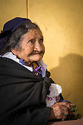 Old lady in Traditional dress, Vegetable seller, Otavalo food Market. , Ecuador, South America
