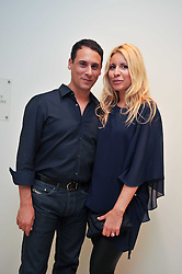 RONNIE LEDANI and his wife BEVERLY BLOOM at an exhibition of photographic portraits by Bryan Adams entitled 'Hear The World' at The Saatchi Gallery, King's Road, London on 21st July 2009.