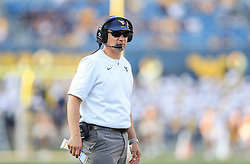 Sep 11, 2021; Morgantown, West Virginia, USA; West Virginia Mountaineers head coach Neal Brown watches along the sideline during the second quarter against the Long Island Sharks at Mountaineer Field at Milan Puskar Stadium. Mandatory Credit: Ben Queen-USA TODAY Sports