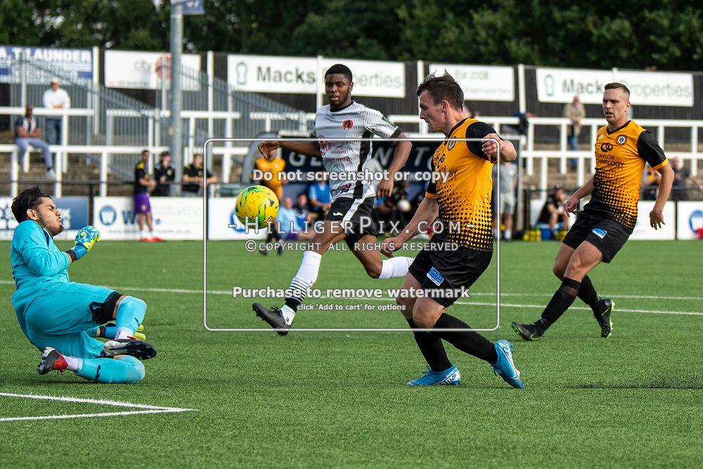 BROMLEY, UK - SEPTEMBER 08: David Trivino, of Bedfont Sports, saves the shot from 'Tom Carlse, of Cray Wanderers FC, during the Emirates FA Cup First Qualifying Round match between Cray Wanderers FC and Bedfont Sports Club at Hayes Lane on September 8, 2019 in Bromley, UK. <br /> (Photo: Jon Hilliger)