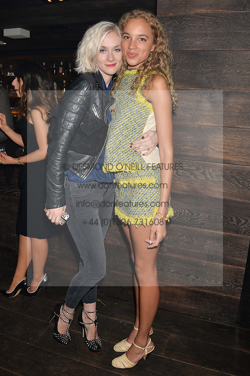 Left to right, PORTIA FREEMAN and PHOEBE COLLINGS JAMES at the Lancôme pre BAFTA party held at The London Edition, 10 Berners Street, London on 14th February 2014.