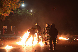 November 17, 2018 - Thessaloniki, Greece - Riot police officers try to avoid molotov coctails during clashes with protesters. Thousands of people marched to the U.S. Consulate through the streets of Thessaloniki to commemorate a 1973 student uprising that was brutally crushed by Greece's military dictatorship, that ruled the country from 1967 to 1974. (Credit Image: © Giannis Papanikos/ZUMA Wire)