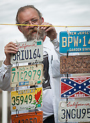Lazarus Lake, Race Director of the Barkley Marathons held every spring in Frozen Head State Park in TN., hangs license plates from the first time runners.