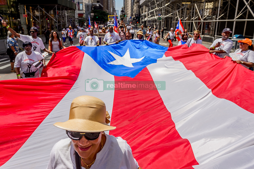 June 11, 2017 - New York, United States - The National Puerto Rican Day Parade (NPRDP) is the largest demonstration of cultural pride in the nation. Now in its 60th year, the parade takes place on June 11, 2017; from 44th Street to 79th Street along Fifth Avenue in Manhattan, in honor of the 3.5 million inhabitants of Puerto Rico and over 5 million people residing in the United States. (Credit Image: © Erik Mcgregor/Pacific Press via ZUMA Wire)