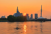 Canadian Museum for Human Rights (CMHR) and the Esplanade Riel Bridge and the Red River at sunset<br /> Winnipeg<br /> Manitoba<br /> Canada