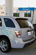 Filling up General Motor's new hydrogen fuel cell Equinox SUV. Shell Hydrogen Refuelling Station, opened June 26, 2008. It is the first retail Hydrogen refuelling station in California.  West Los Angeles, USA