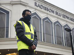 © Licensed to London News Pictures. 15/02/2021. London, UK. A security guard stands at the entrance to the Radisson hotel near Heathrow Airport as the first passengers go into quarantine. People entering the UK from a 'red list' of 33 high risk countries will have to quarantine at hotels for 10 days to try and stop new coronavirus variants entering the country. Photo credit: Peter Macdiarmid/LNP