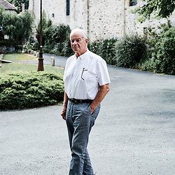 Gilbert Chabaud, the mayor, posing in the center of the village. Saint-Pierre-de-Frugie, France. July 12, 2019.<br /> Gilbert Chabaud, le maire, posant dans le centre du village. Saint-Pierre-de-Frugie, France. 12 juillet 2019.