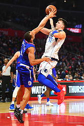 December 21, 2018 - Los Angeles, CA, U.S. - LOS ANGELES, CA - DECEMBER 20: Dallas Mavericks Guard Luka Doncic (77) goes up for a basket over Los Angeles Clippers Guard Avery Bradley (11) during a NBA game between the Dallas Mavericks and the Los Angeles Clippers on December 20, 2018 at STAPLES Center in Los Angeles, CA. (Photo by Brian Rothmuller/Icon Sportswire) (Credit Image: © Brian Rothmuller/Icon SMI via ZUMA Press)