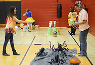 Middletown, New York  - Volunteers play games in the gymnasium during the Middletown YMCA Family Fall Festival on Oct. 29, 2011. ©Tom Bushey / The Image Works
