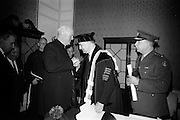 19/05/1966<br /> 05/19/1966<br /> 19 May 1966<br /> President Eamon de Valera receives Honorary Doctorate from the University of Louvain, Belgium at a conferring ceremony at the Department of External Affairs in Dublin. Picture shows His Eminence, Cardinal William Conway, Archbishop of Armagh and Primate of All Ireland congratulating President de Valera on the conferring.