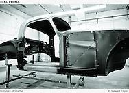 MGA Coupe. Applying etching primer to bare metal areas.