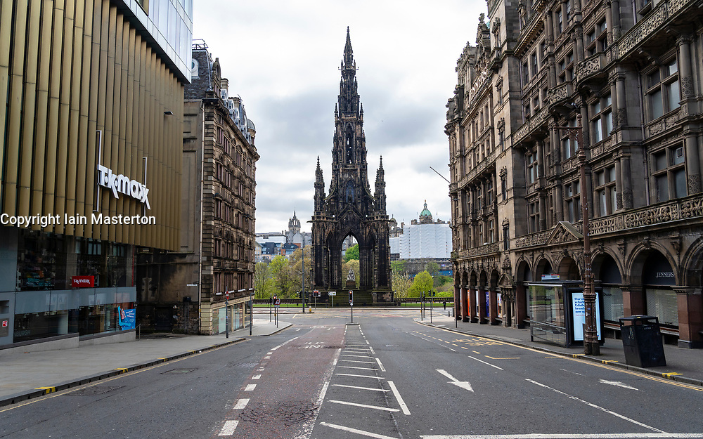 Edinburgh, Scotland, UK. 1 May 2020. Views of Edinburgh as coronavirus lockdown continues in Scotland. Streets remain deserted and shops and restaurants closed and many boarded up. Pictured; Scott Monument and deserted streets in the city centre.. Iain Masterton/Alamy Live News