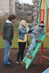 White family at playground.