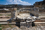 Picture of the Nymphaeum Fountain located inside the sacred area in front of the Apollo temple on the main colonnaded road. Dated from the 2nd century AD and repaired in the 5th century during the Byzantine era. Hierapolis archaeological site near Pamukkale in Turkey. .<br /> <br /> If you prefer to buy from our ALAMY PHOTO LIBRARY  Collection visit : https://www.alamy.com/portfolio/paul-williams-funkystock/pamukkale-hierapolis-turkey.html<br /> <br /> Visit our TURKEY PHOTO COLLECTIONS for more photos to download or buy as wall art prints https://funkystock.photoshelter.com/gallery-collection/3f-Pictures-of-Turkey-Turkey-Photos-Images-Fotos/C0000U.hJWkZxAbg