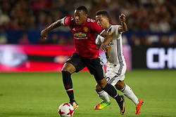 July 15, 2017 - Carson, California, U.S - Manchester United F Anthony Martial (11) and Los Angeles Galaxy M Giovani dos Santos (10) in action during the summer friendly between Manchester United and the Los Angeles Galaxy at the StubHub Center. (Credit Image: © Brandon Parry via ZUMA Wire)