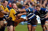 Photo: Richard Lane.<br />Bath Rugby v London Wasps. Zurich Premiership.<br />07/02/2004.<br />Zak Feaunati hands off Alex King.
