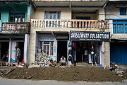 Men dig a trench for a pipe during road works along the main street through the centre of Besishahar on the 10th of March 2020, Besishahar, Lamjung District, Gandaki Pradesh, Nepal. Besishahar is a small town, municipality and the district headquarters of Lamjung District in Gandaki Pradesh, Nepal