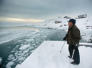 Rasmus Igniatiussen, one of the old hunter - he killed over 22 Polar bears - on his morning routine of looking for seals. Life in and around the small Inuit settlement of Isortoq (population of 64), in East Greenland.