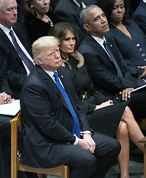 United States President Donald J. Trump looks on during the National funeral service in honor of the late former United States President George H.W. Bush at the Washington National Cathedral in Washington, DC on Wednesday, December 5, 2018. Also pictured are: First lady Melania Trump, former US President Barack Obama, former first lady Michelle Obama. Former US Vice President Dan Quayle is pictured at top left.<br /> Photo by Ron Sachs / CNP/ABACAPRESS.COM