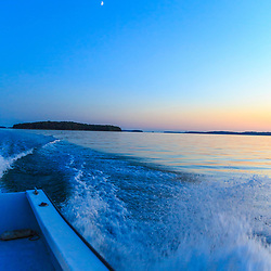 Boating at dusk in Casco Bay. Brunswick, Maine.