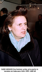 SUZIE MENKES the fashion writer, at a party in London on February 24th 1997.LWR 53