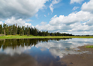"""Whirlpool Lake on a bright summer afternoon, in Riding Mountain National Park, Manitoba   Each 252-piece photo puzzle comes in a sturdy, finished cardboard box and measures 10"""" x 14"""" when complete"""