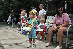 Patriotic youngsters await arrival of parade bands. Stock photo