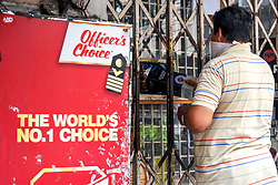 A man buying liquor from a shop in Kolkata, India on May 5, 2020. Goverment ordered to open liquor shop amidst 14 days of extended lockdown in India. Guidelines were put forth and social distancing protocols were ordered to be followed at any cost during working hour of the liquor shop in the country. Photo by Debarchan Chatterjee/ABACAPRESS.COM