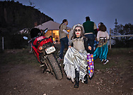 Girl trick or treating in Fort Davis, Texas.