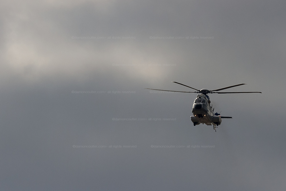 """A Airbus Helicopters H225M """"Super Puma"""" operated by ATLA (Acquisitiions, Technology and Logistics Agency) which is part of the Japanese Ministry of Defense flying near Naval Air Facility, Atsugi, Yamato, Kanagawa, Japan. Wednesday January 23rd 2019"""