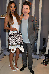 Left to right, JOURDAN DUNN and NICK GRIMSHAW at a Dinner to celebrate the launch of the Mulberry Cara Delevingne Collection held at Claridge's, Brook Street, London on 16th February 2014.