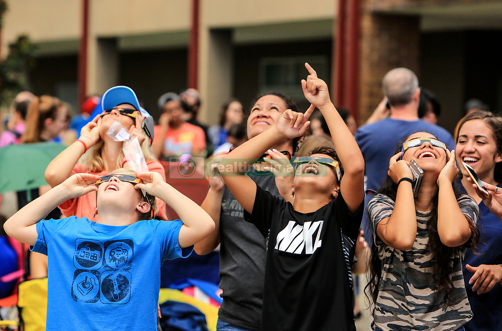 Children look toward the sky during an Eclipse 2017 Observing Event at Seminole State College on Monday afternoon, Aug. 21, 2017. The Buehler Planetarium at Seminole State College hosted the event and had filtered telescopes and binoculars set up for viewing the eclipse. They also handed out viewing glasses for the first 5,000 visitors. Photo by Jacob Langston/Orlando Sentinel/TNS/ABACAPRESS.COM