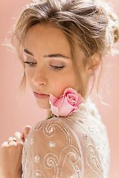Beauty Portrait of Woman Holding Rose