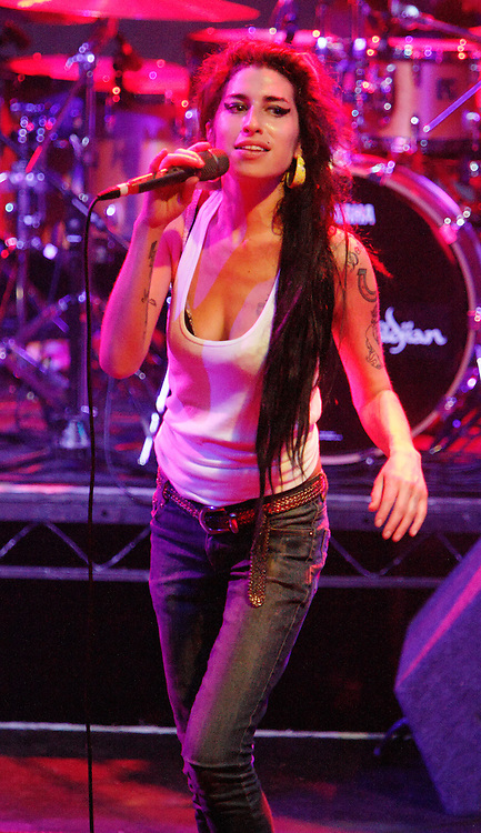 Singer Amy Winehouse, DOB=14/09/1983, performing for her gay fans at the G-A-Y Club. G-A-Y is London's biggest gay club and is held at the London Astoria nightclub, Soho, London, UK. Amy spent much of the show rubbing her itchy nose. She also seemed to have signs of old scars all down one arm...Picture Data:.Photographer: Edward Hirst.Copyright: ©2007 Licensed to Equinox News Pictures +448700 780000.Contact: Equinox Features.Date Taken: 20070415.Time Taken: 020302+0000.www.newspics.com
