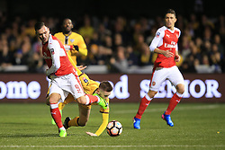 20 February 2017 - The FA Cup - (5th Round) - Sutton United v Arsenal - Lucas of Arsenal in action with Adam May of Sutton United - Photo: Marc Atkins / Offside.